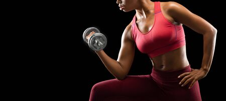 Cropped image of african athletic girl pumping barbell with one hand over black background, gym concept, panorama with free space