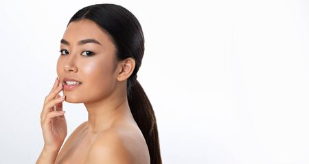 Cosmetology concept. Girl with smooth skin posing to camera over white background, panorama with free space