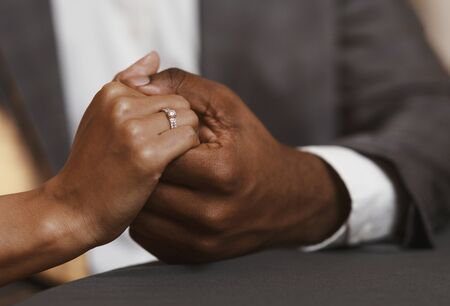 Engagement concept. Cropped image of black couple in restaurant, woman said yes on marriage proposing