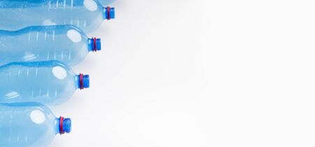 Environment concept. Set of water plastic bottles in a raw isolated on white, panorama, copy space