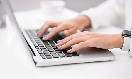 Writing Blog. Unrecognizable woman working on laptop, searching information. Selective focus, copyspace