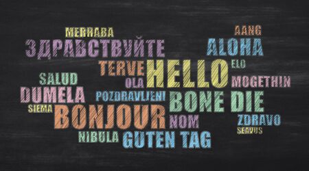Hello Word In Different Languages On Black Chalkboard. Greeting Wordcloud Collage. Learn Foreign Language Concept. Panorama Banco de Imagens