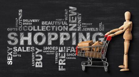 Shopping Conceptual Wordcloud With Wooden Man And Buyers Shopper Cart Over Black Chalkboard Background. Panorama