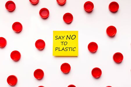 Say no to plastic text. Pattern Background with colored plastic covers, earth pain points