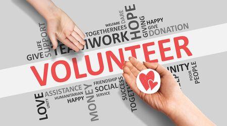Voluntariado y Caridad. Manos dando imagen de corazón en Wordcloud voluntario fondo blanco con palabras. Panorama Foto de archivo