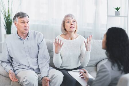 Therapy Session. Unhappy senior wife talking to psychologist counselor complaining about bad relationship with husband Archivio Fotografico