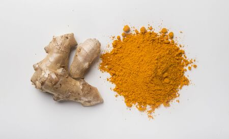 Turmeric powder and curcuma root on white background. Spice and medicinal herb, prevention of heart diseases