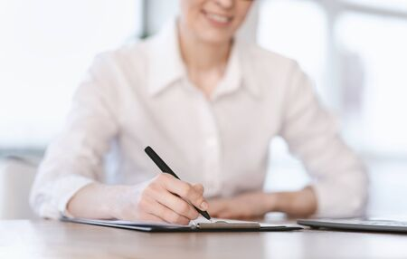 Unrecognizable Office Lady Writing Short Account Of Her Career Sitting At Workplace. Employment Concept. Selective Focus, Cropped