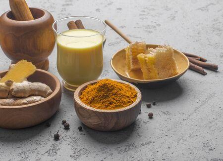 Trendy Asian natural detox beverage milk or latte with spices for vegans, concrete