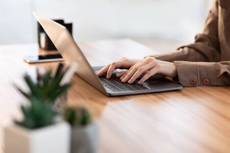 Information Searching. European girl using laptop, close up of female hands, free space