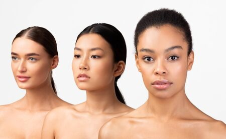 Multiracial Beauty. Three Diverse Young Women Standing Posing On White Background. Studio Shot, Isolated, Selective Focus