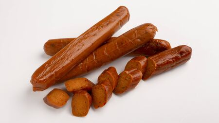 Food swap. Meat free smoked sausage isolated on white background, empty space