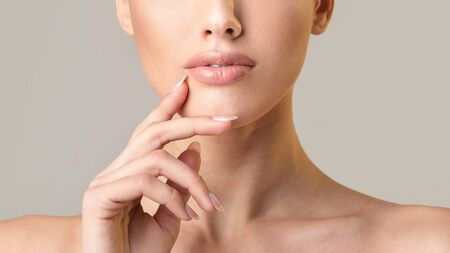 Beauty. Unrecognizable Young Lady Touching Face Posing On Beige Studio Background. Cropped, Panorama