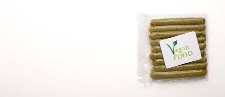 Logo vegan food on appetizing meatless green sausages panorama, free space Stockfoto