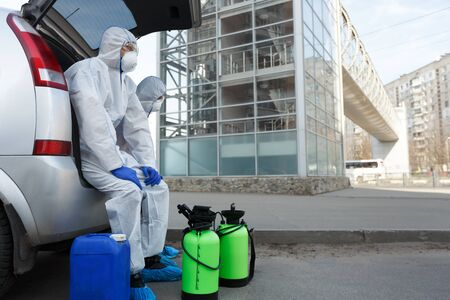 Medical Physician scientist make disinfection outdoor and in public places, copy space