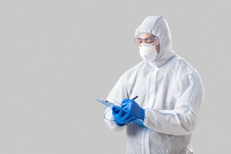 Biological hazard covid-19. Asian male scientist takes notes