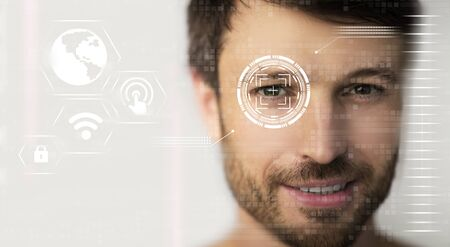 Data protection concept. Retina scan of young male, collage with information on digital screen. Empty space. Panorama 版權商用圖片