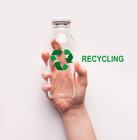 Reusable waste concept. Woman holding glass bottle with recycling emblem on white background, top view. Collage Foto de archivo