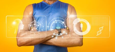 Modern Technology Concept. Muscular black man with folded arms wearing wristband with HUD futuristic elements interface Stock Photo