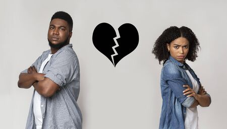Breakup And Divorce Concept. Collage Of Unhappy Black Couple Standing Back To Back With Ripped Heart Symbol Icon Between Them Over Light Background