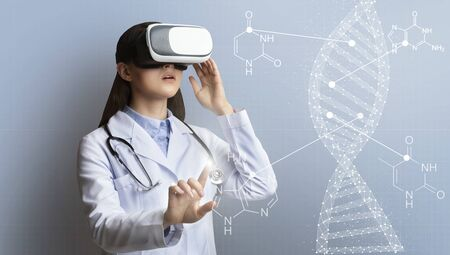 Medical technology concept. Collage with female medic wearing virtual reality headset and DNA molecule on virtual screen, panorama Stock Photo