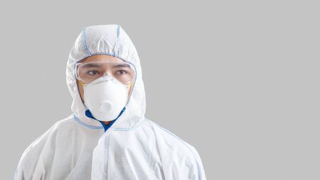 2019-ncov epidemic. Asian male disinfector in protective mask, suit and glasses