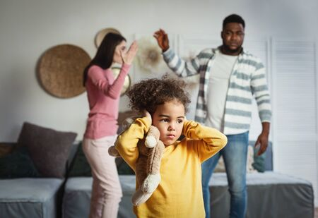 International family breaks up, child covers ears and afraid Stock fotó
