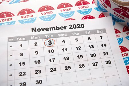 American elections 2020, 3 of November. Calendar sheet with circled date of vote day, stickers for voters