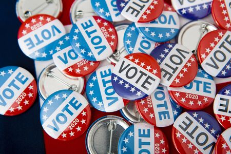 Politics Democratic Party in the US, elections 2020, button pins on American flag