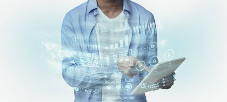 Black man using digital tablet, panorama. Double exposure infographic panel with digital charts Foto de archivo