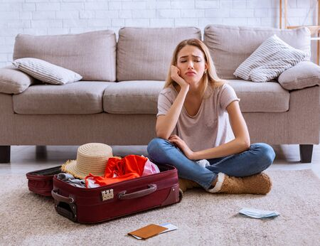 Summer without vacation. Young woman sitting at home on self-quarantine