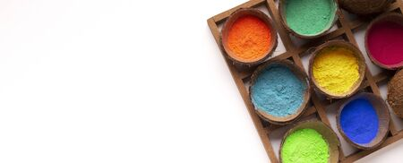 Bright paint in coconut shell for Holi, panorama