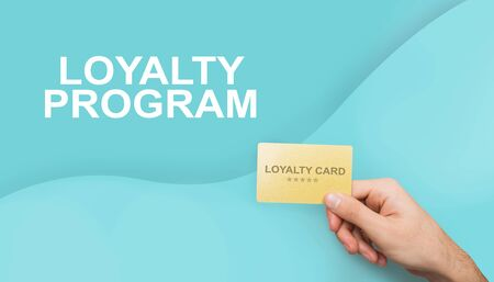 Collage with unrecognizable consumer showing loyalty card on color background, closeup. Panorama Imagens