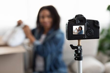 Video Blog. Selective Focus On Camera Recording Content For Young Black Girl Fashion At Home, Closeup Reklamní fotografie