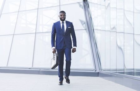 Successful Business People. African Businessman With Briefcase Walking In Urban Area In City. Full Length, Copy Space