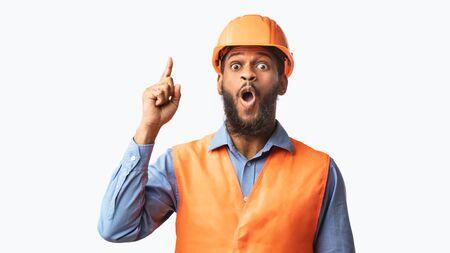 Great Idea. Black Builder Worker Pointing Finger Up Having Plan Posing On White Studio Background. Panorama