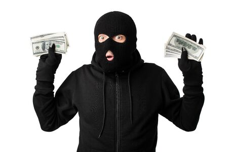 Being Caught Concept. Arrested masked thief holding money, raising arms isolated on white studio background