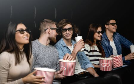 Friday night fun. Happy friends on 3D movie premiere in cinema Stock fotó - 148182135
