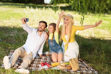 Summer Fun. Happy Family On Picnic Making Selfie Spending Sunny Day Together In Nature Outdoor After Quarantine And Parks Reopening. Stock fotó