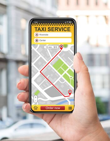 Taxi service online app. Man hand holding cell phone with map for destination place