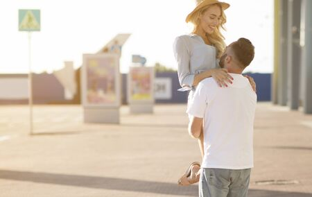Summer Vacations and Love Concept. Portrait of cheerful spouses hugging outdoors near the airport