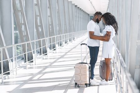 Post-Quarantine Meeting. Romantic Couple Embracing In Airport Terminal, Happy To See Each Other After Long Lockdown Due To Covid-19, Copy Space Banque d'images