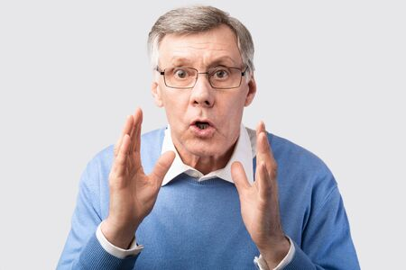 Shocked Elderly Man Looking At Camera Posing Over Gray Studio Background. Dont Do It, Warning Concept