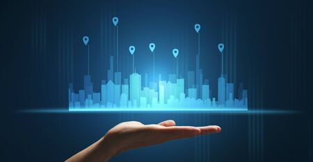 City Logistics Network. Hand Holding Holographic Urban Buildings On Blue Background. Panorama, Cropped