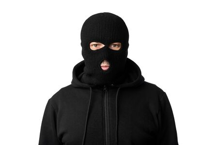 Riots, Robbery and Marauding Concept. Portrait of disguised villain in black mask posing at camera on white background Stockfoto