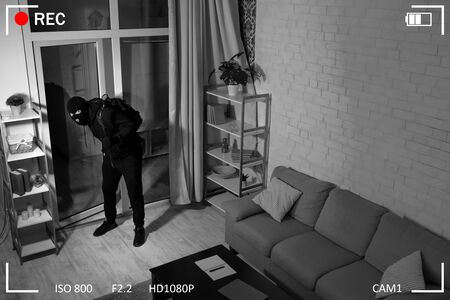 Surveillance Concept. Thief With Crowbar Wearing Balaclava Entering House, Scene Through CCTV Camera, High Angle View