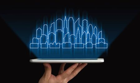 Smart City. Hand Holding Tablet With Futuristic Holographic Cityscape Project Over Black Background. Collage, Cropped