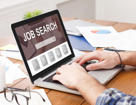 Hiring Website Concept. Closeup of man looking for open vacancies on job search site, using pc, typing