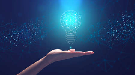 Creativity And Innovations. Male Hand Holding Abstract Light Bulb Made Of Polygonal Connections Over Blue Futuristic Background, Panorama