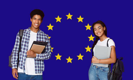 Study Abroad In Europe. Happy Black Guy And Girl College Students Posing Over EU Flag Background, Creative Collage